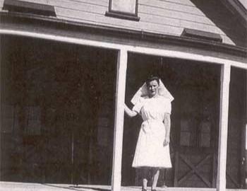 Sister Roma Drain standing on the verandah of the Hospital in 1946.